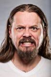 有看起来长的头发的白种人人恼怒 免版税库存照片