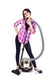 有真空吸尘器的女孩 免版税图库摄影