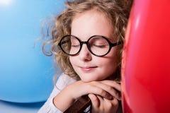 有眼睛结束的作梦的女孩 免版税图库摄影