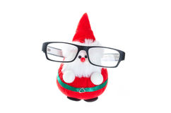 有眼睛玻璃的逗人喜爱的圣诞老人玩偶 库存照片