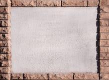 有砖框架的混凝土墙 免版税图库摄影