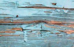 有破裂的油漆的,葡萄酒,木头,背景老蓝色委员会 免版税库存照片