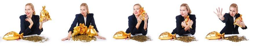 有硬币和金黄大袋的妇女 免版税库存图片