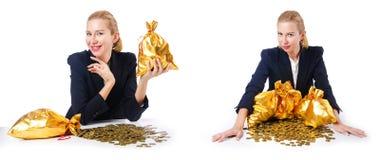 有硬币和金黄大袋的妇女 免版税库存照片
