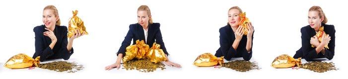 有硬币和金黄大袋的妇女 库存图片