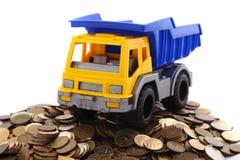 有硬币的卡车 库存照片