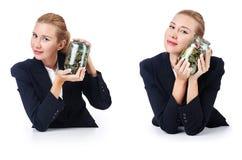 有硬币的女实业家在白色 免版税库存图片