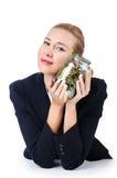 有硬币的女实业家 免版税图库摄影
