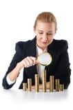 有硬币的女实业家 免版税库存图片