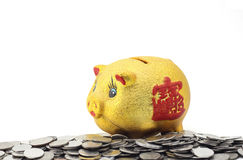 有硬币的存钱罐 免版税库存图片