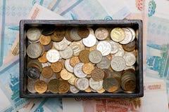 有硬币的配件箱 库存图片