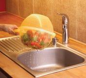 有碗的滤锅 库存图片