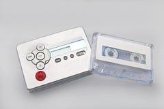 有磁带的卡式磁带播放机在灰色背景 免版税图库摄影