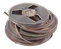 有磁带的老葡萄酒片盘在白色 免版税库存照片