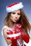 有礼品的圣诞节妇女 免版税图库摄影