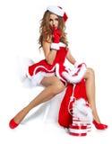 有礼品的圣诞节妇女 库存图片
