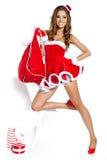 有礼品的圣诞节妇女 免版税库存图片