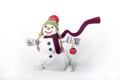 有礼品的愉快的雪人 免版税库存照片