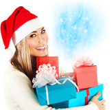 有礼物的圣诞老人女孩 库存图片