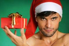 有礼物的性感的圣诞老人 免版税图库摄影
