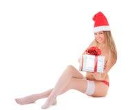 有礼物的美丽的裸体圣诞老人妇女 图库摄影
