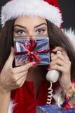 有礼物盒的快乐的圣诞老人女孩 库存图片