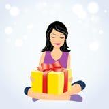 有礼物盒的愉快的女孩 库存图片