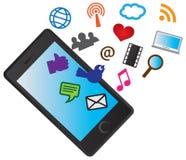 有社会媒体图标的移动手机 免版税库存照片