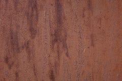 有离婚纹理被弄脏的斑点的生锈的篱芭墙壁 免版税库存图片