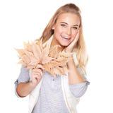 有秋天花束的美丽的妇女 图库摄影
