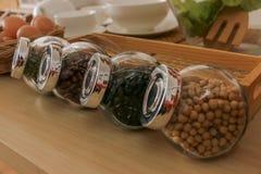 有种子的透明瓶 免版税库存照片
