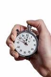 有秒表的手 免版税库存图片