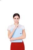 有秘密和做静寂姿态的企业衣裳的年轻女商人 查出 免版税库存图片