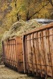 有秸杆的两个橙色容器从在干净以后的马槽枥 免版税库存图片