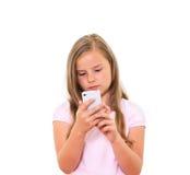 有移动电话的女孩。 库存图片