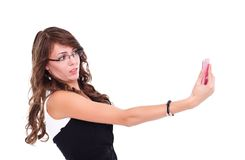 有移动电话的惊奇的妇女 免版税库存图片