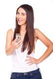 有移动电话的美丽的妇女在手中 免版税库存照片