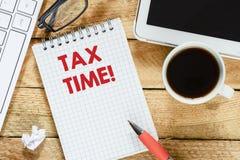 有税时间的笔记本 库存图片