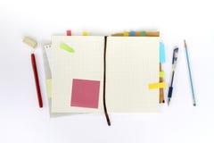 有稠粘的笔记的笔记本 免版税图库摄影