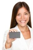 有空插件的微笑的女商人 免版税库存图片