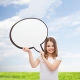 有空白的文本泡影的微笑的小女孩 库存图片