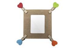 有空白的框架的四个心脏夹子 免版税库存照片
