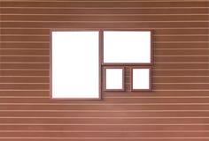 有空白的框架的木墙壁 库存照片