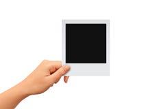 有空白的照片卡片的手 免版税库存照片