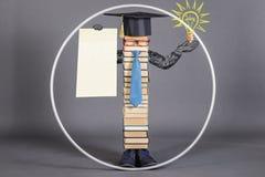 有空白的白皮书的现代教育的聪明的Vitruvian人 库存照片