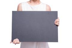 有空白的黑板的女性手举行 库存照片