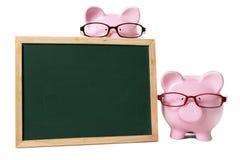 有空白的黑板的存钱罐 库存图片