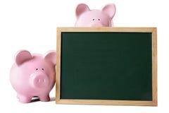 有空白的黑板的存钱罐 库存照片