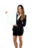 有空白符号的美丽的微笑的女商人 免版税库存照片