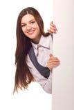 有空白董事会的新微笑的妇女 免版税库存照片